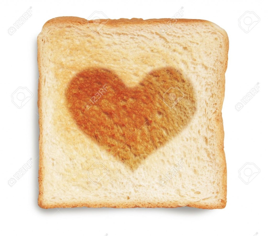 9353221-toasted-bread-with-heart-shape-burnt-Stock-Photo-toast
